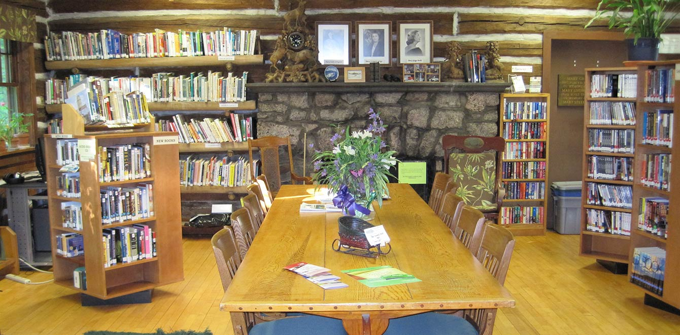 The large table in The Forest Lodge Library in Cable, Wisconsin makes a great work space.